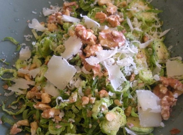 Brussels sprouts are delicious raw, when thinly shaved and mixed with lemon, toasted walnuts and pecorino romano in this wintry slaw.