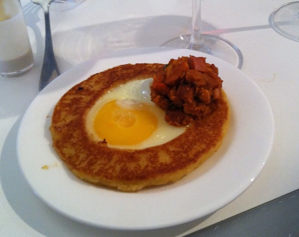 Douglas Rodriguez' Sweet Corn Arepa was topped with a runny egg and chicken hash.